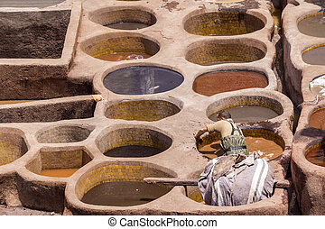 Fes el Bali worker the dye pots at leather traditional...