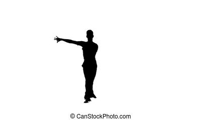 Silhouette man is dancing elements of salsa dance, slow...