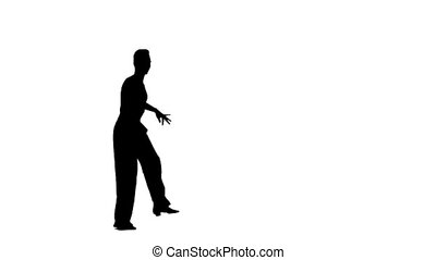 Solo man is dancing elements of ballroom. Silhouette, slow...