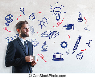 Education concept - Handsome young businessman drinking...