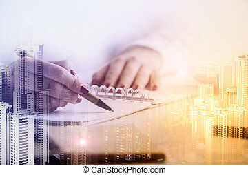 Woman writing in notepad multiexposure - Close up of female...