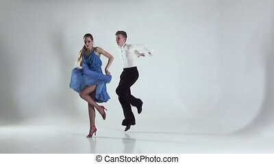 Couple is ballroom dancing on white background, shadow. Slow...