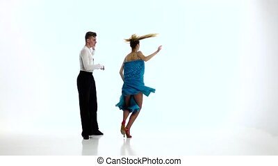 Tango dancing couple of professional elegant dancers,slow...