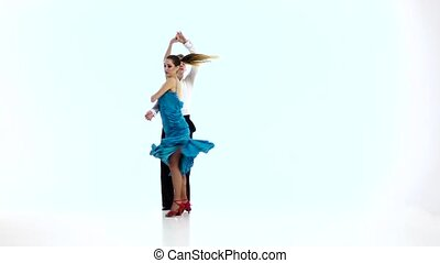 Pair of professional dancers perform salsa, white...