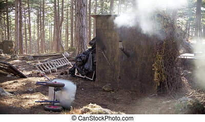 Lumberjack house in the forest with chimney smoke