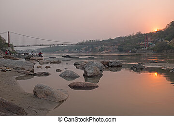At the river Ganges in India at sunset - At the river Ganges...