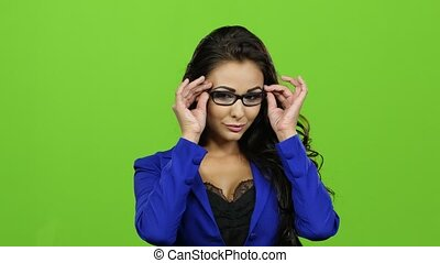 Sexy teacher with glasses threatens with her finger, green...