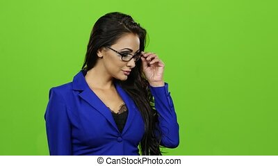 Woman in glasses flipping through virtual slides. Green...