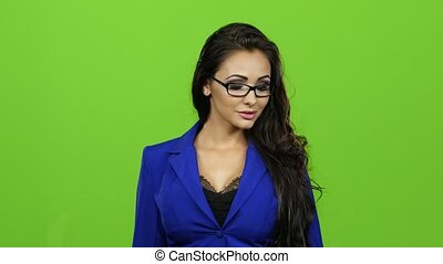 Gesture all okay shows sexy woman in glasses, green screen -...