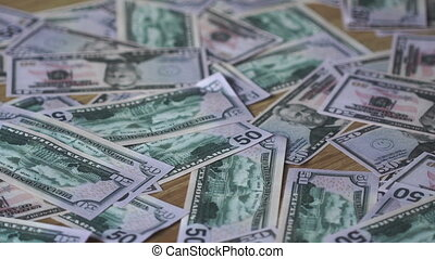 a bunch of money lying around on the floor - close up of a...