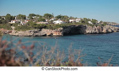 People bathe and rest on the beach. Spanish beaches in Cala...