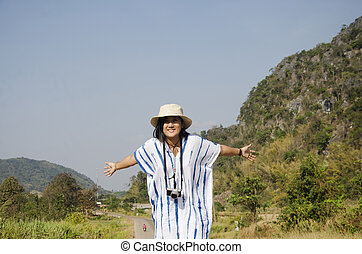 Thai women people travel and posing on the road go to Suan...