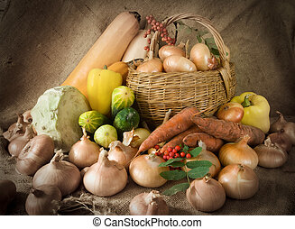 vegetables on sacking - still life from harvested onion and...