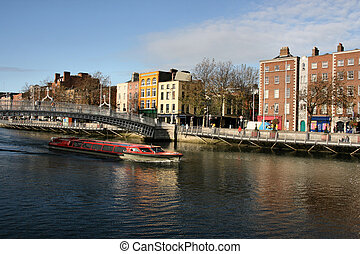 Dublin - Hapenny Bridge and Liffey river cruise boat in...