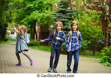 Three little friends hurry on lessons in school. The...