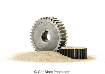 sand in the gears - cogs with sand isolated on white...