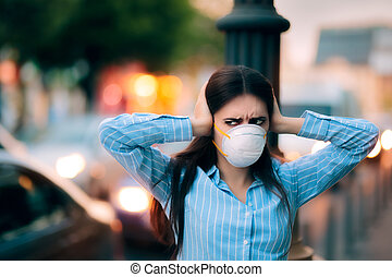 Girl With Mask Covering her Ears Because of Noise Pollution