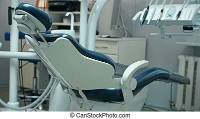 Dental Chair Is Unfolded Automatically In Dentist Office....