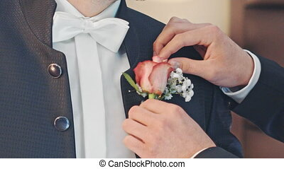 wear the boutonniere on suit jacket.