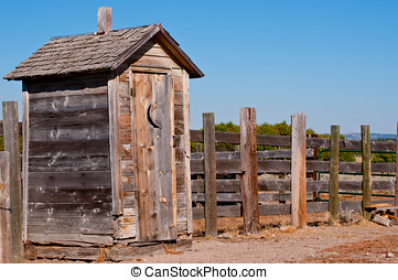 Old weathered outhouse - Vintage style bathroom at the...