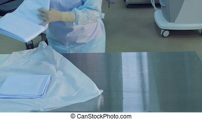 Preparing an operating room. - Surgical assistants prepare...