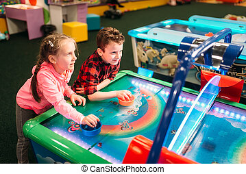 Little kids plays air hockey, entertainment center - Little...