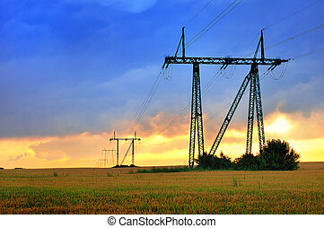 Electric power line at sunset