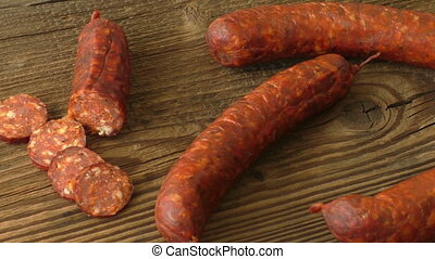 Homemade sausages on a wooden background