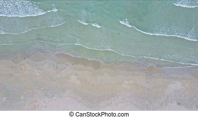 Drone Flies over Sea Waves Surf Rolling on Sand Beach
