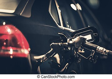 Gasoline Car Refueling Closeup Photo. Night Time Vehicle at...