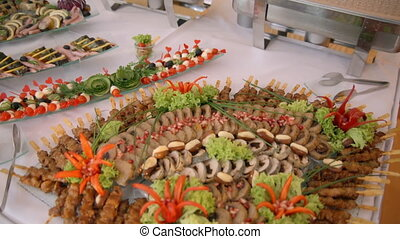 buffet, snacks and salads on the plates