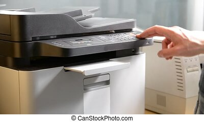 Hand printing document on printer or fax - Male hand...
