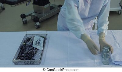 Preparing a surgical instrument - Surgical assistants...