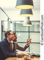Men at work - Smiling men in suit in studio