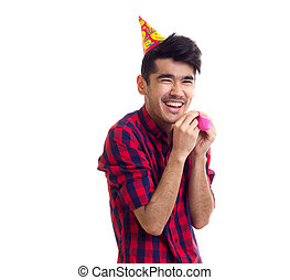 Young man blowing balloon - Young happy man in red plaid...