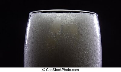Close-up of beer foam on a black background HD
