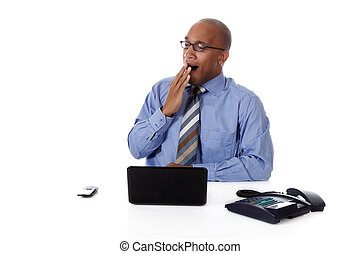 Young attractive African American businessman in office...