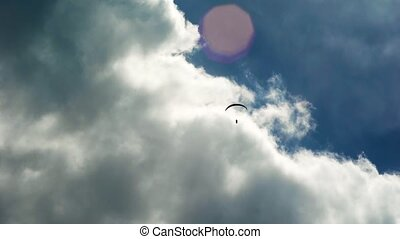 The paraglider in the sky, flies in the air streams....