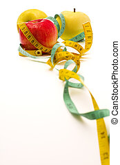 Apple and meter - Tape measure wrapped around applies, focus...
