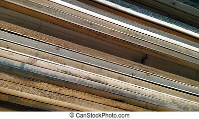 Stacked timbers creates diagonal lines. Mobile photography.