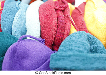 Assorted beanie hats on display.