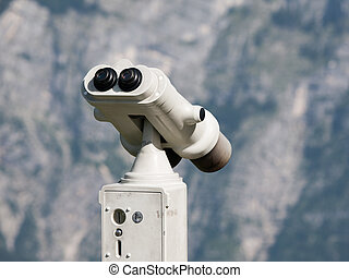 Touristic metal binoculars for mountain panorama observation. Detailed view