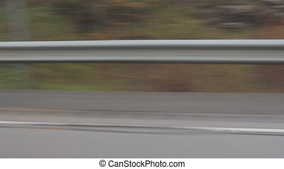 Highway guard rail. - View from passenger window of highway...