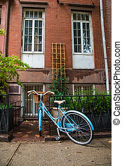 Old bicycle locked on the street in New York City - All...