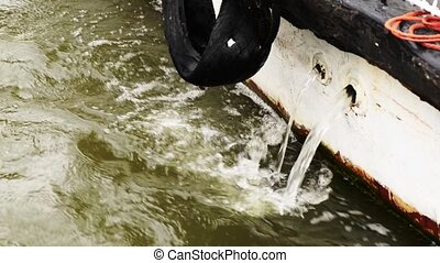 water is discharged from the ship - discharge water after...