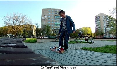 boy learns to ride a skateboard - inexperienced kid learns...