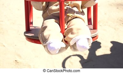 Legs of adorable baby girl on swing - Legs of adorable baby...