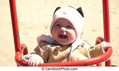 Amazing cute adorable baby girl on swing