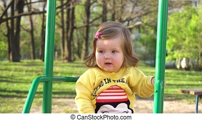 Cute adorable baby girl on swing - Cute adorable baby girl...