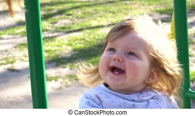 Smiling cutie adorable baby girl on swing - Smiling cutie...